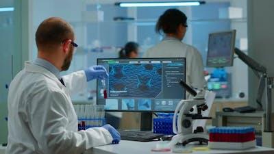 Scientist Man Examining Blood Samples