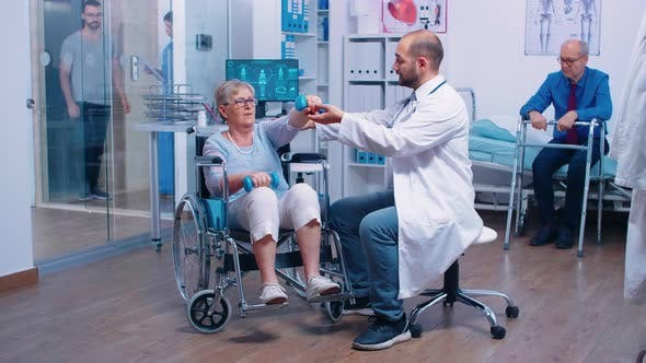 Thumbnail for Doctor Helping Old Woman in Wheelchair