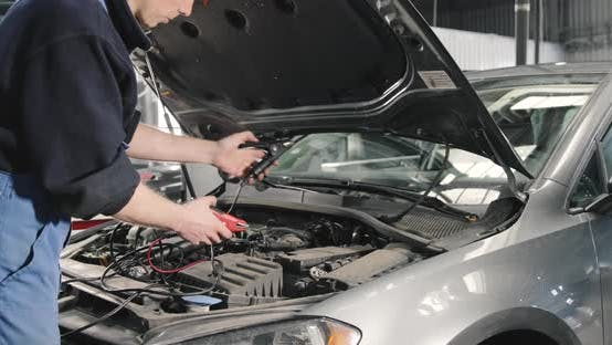 Thumbnail for Car Mechanic Checking Power Voltage Of Car Battery In The Workshop