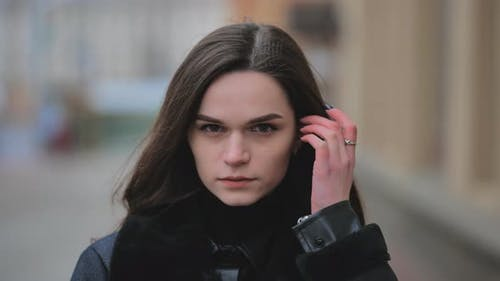 Portrait of a Young Girl on a City Street in Early Spring
