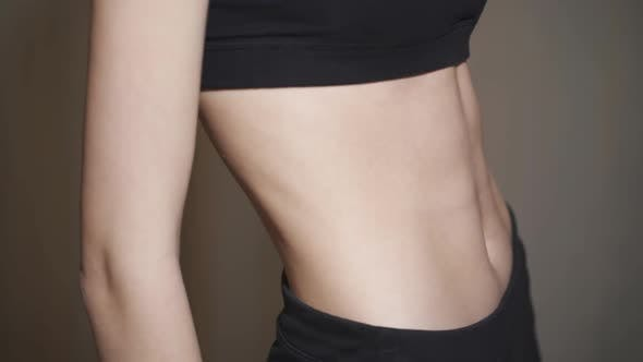 Thumbnail for Fitness Woman Demonstrates Her Trained Belly