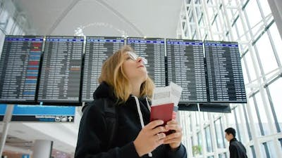 Young Woman Travel Abroad. Tourist Go Home Airport