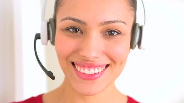 Hispanic woman with headset in customer support