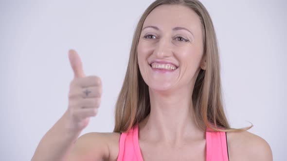 Thumbnail for Face of Happy Blonde Woman Giving Thumbs Up