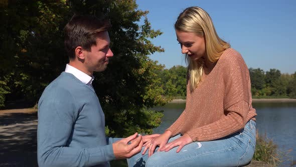 A Man Proposes To His Girlfriend in a Park