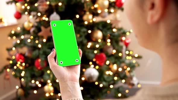 Thumbnail for Woman with Green Screen on Smartphone on Christmas