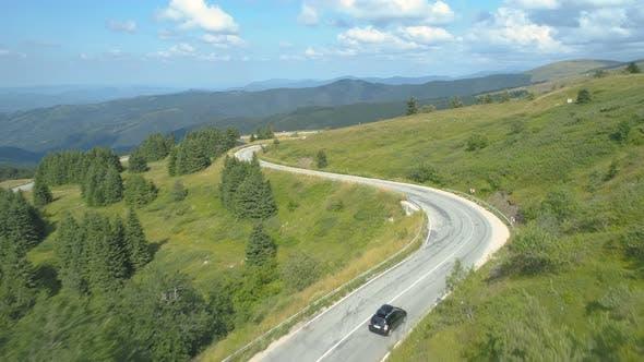 Thumbnail for Drone Following Car Down Winding Mountain Road