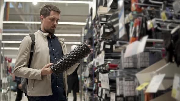 Man Chooses New Massage Roller