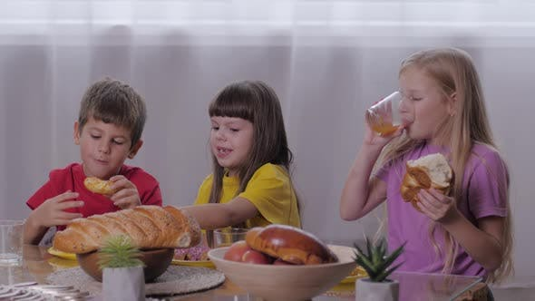 Thumbnail for Children Eat, Cheerful Company of Friends of Kids Takes an Afternoon Snack, Bites Pastries and