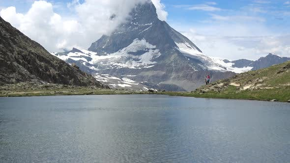 Scenic view on snowy Matterhorn peak and lake Stellisee, Swiss Alps, Zermatt