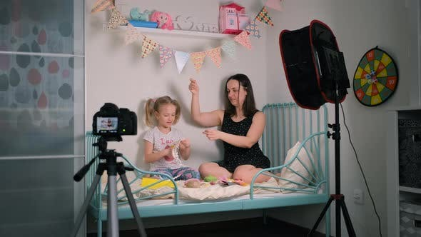 Little Girl with Mother Shooting Crafting Vlog