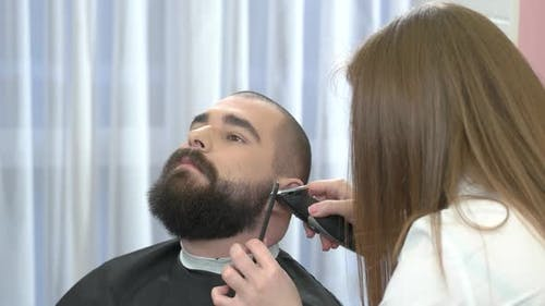 Female Barber Grooming Beard