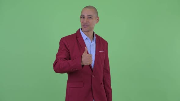 Thumbnail for Happy Bald Multi Ethnic Businessman Giving Thumbs Up