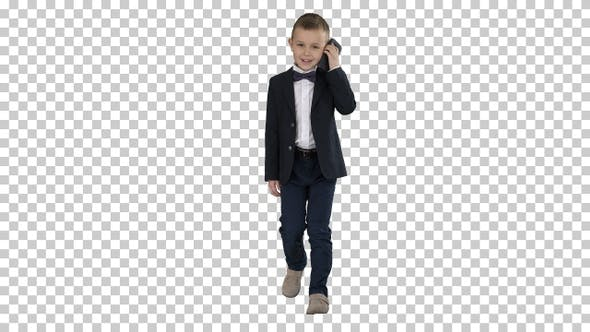 Thumbnail for Little Boy in A Costume Making a Phone Call While Walking Alpha