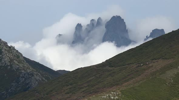 Thumbnail for Clouds Around the Sharp Pointed Rocky Mountain Peak