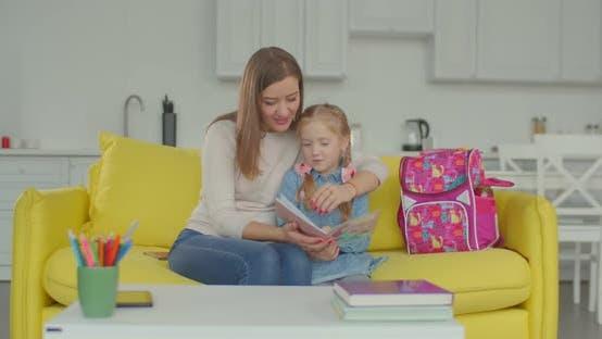 Thumbnail for Proud Mom Praising Schoolgirl for Studying Well