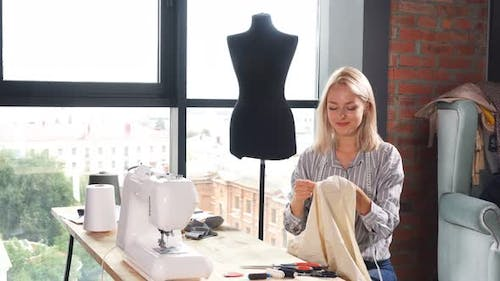 Lovely Blonde Dressmaker Is Good at Embroidery