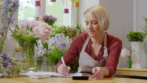 Thumbnail for Flower shop manager doing accounting