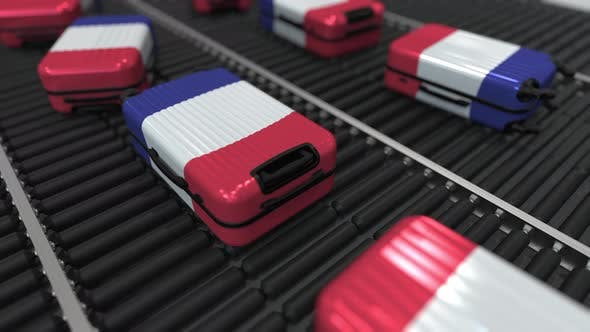 Thumbnail for Suitcases Featuring Flag of France Move on the Conveyor