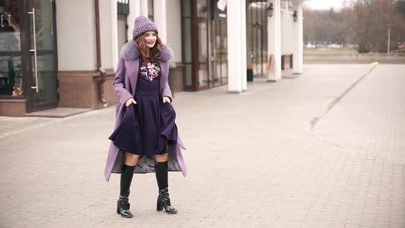Thumbnail for Trendy Lady in All Violet and Purple Dancing in the Street.