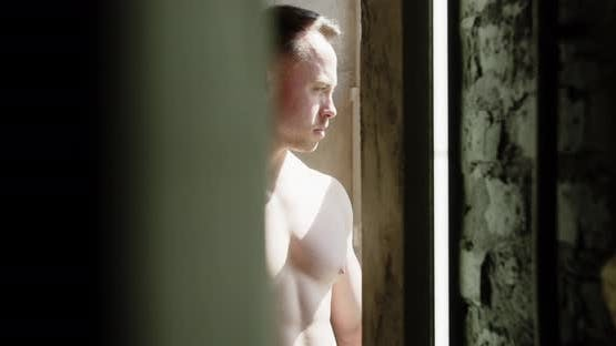 Bodybuilder At The Window Playing Chest Muscles