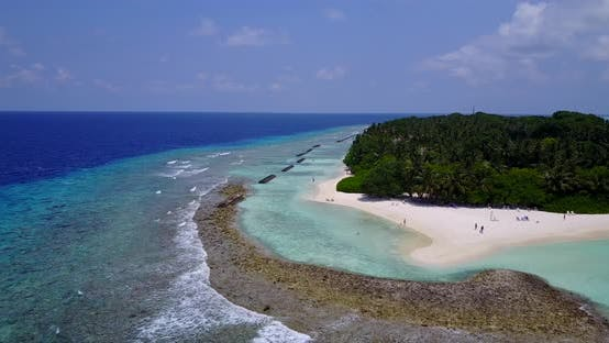 Thumbnail for Wide above island view of a paradise sunny white sand beach and turquoise sea background in colourfu