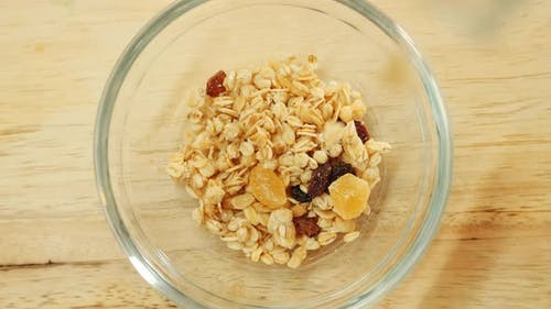 Pouring Muesli Breakfast Mix in Bowl