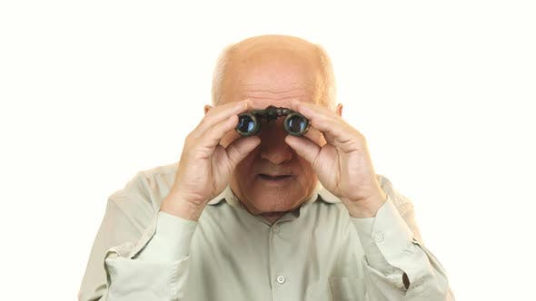 Thumbnail for Old Man Using Binoculars Looking Surprised To the Camera