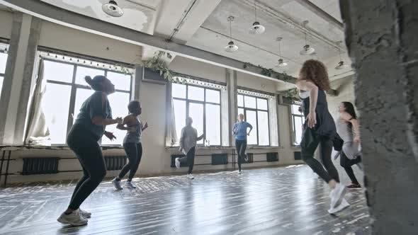 Thumbnail for Energetic Women Doing Aerobics in Circle