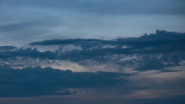 Thumbnail for Fluffy Clouds Moving Fast in Time-lapse From Evening To Night. Sunset. Idyllic Cloudy Heaven