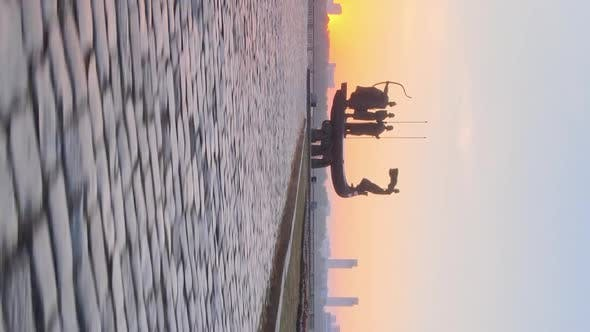 Vertical Video  Monument To the Founders of the City in the Morning at Dawn