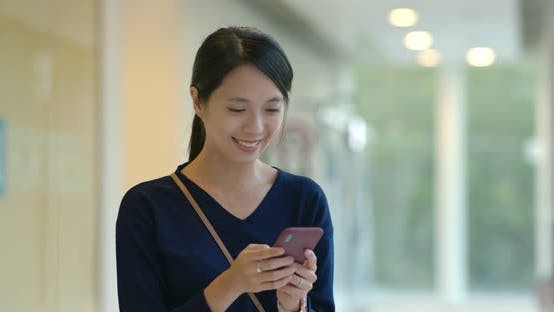 Thumbnail for Woman use of mobile phone inside shopping mall