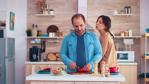 Husband Slicing Tomatoes