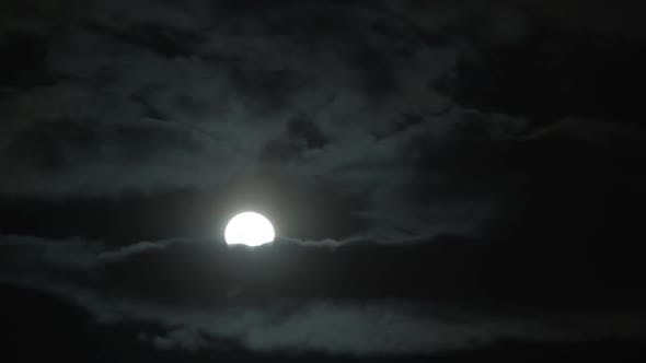 Thumbnail for Bright Lunar Disk Breaking Through Thick Clouds Like Goodness Trying Defeat Evil