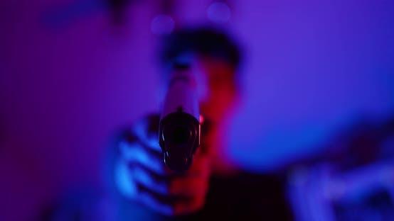 Woman Pointing Gun At Camera