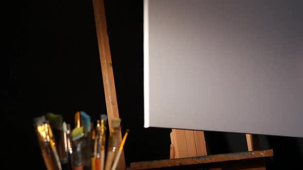 Thumbnail for Equipment for Painting, Rotation Wooden Easel and Painter Puts the Blank Canvas on It