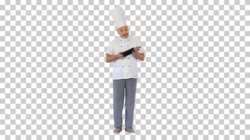 Chef in uniform holding a bottle of wine, Alpha Channel
