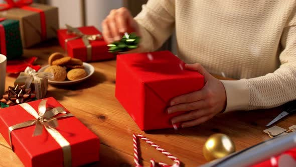 Thumbnail for Hands Packing Christmas Gift and Choosing Bow