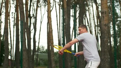 Tennis Player Hitting Forehand in a Tennis Game