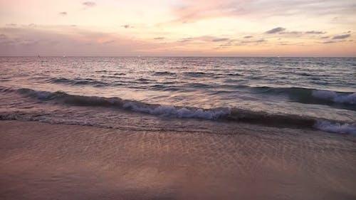 Wonderful Sunset with Ocean Waves on Empty Sandy Beach