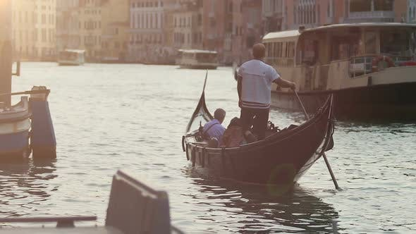 Thumbnail for Gondola and Water Taxi Going Down Channel Carrying People Onboard, Slow Motion