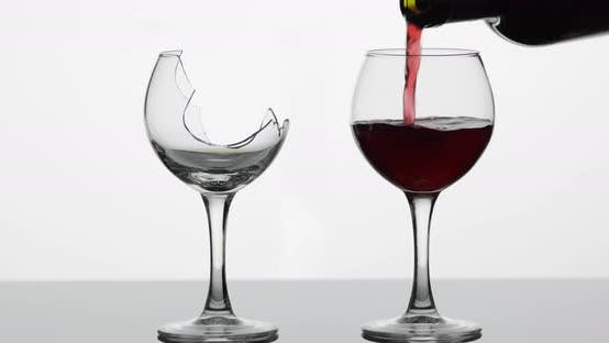 Thumbnail for Wine. Red Wine Pouring Into Normal and Broken Wine Glasses on the Wet Surface