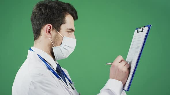 Cover Image for Doctor writing on a clipboard