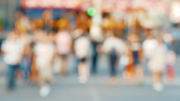 Thumbnail for Pedestrians in Defocus Cross the Road at a Traffic Light During Sunset