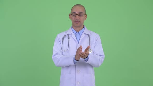 Cover Image for Happy Bald Multi Ethnic Man Doctor Clapping Hands