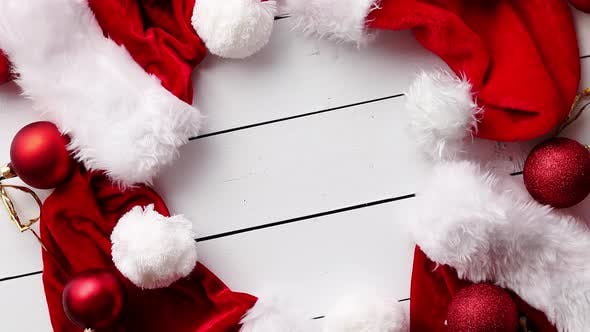 Thumbnail for Santa Claus Hats on White Wooden Desk with Blank Copy Space.
