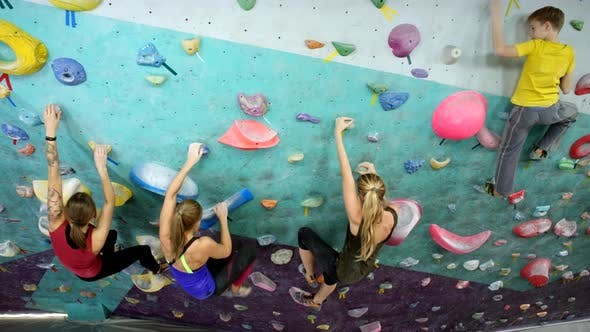 Thumbnail for Group of Trained Climbers Descending from Wall at Indoor Gym