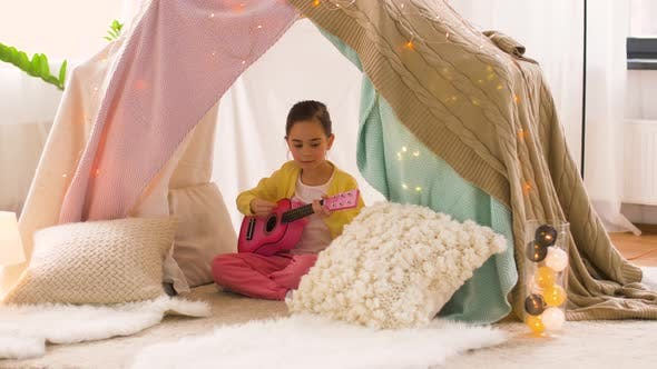 Thumbnail for Girl with Toy Guitar Playing in Kids Tent at Home