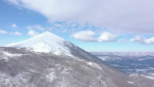 Cloudy sky above  snowed peak of Rtanj mountain 4K aerial video