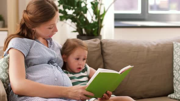 Thumbnail for Pregnant Mother and Daughter Reading Book at Home 13